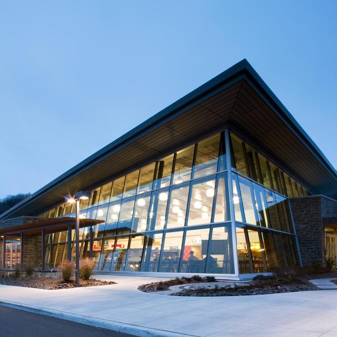 angled glazed façade of an ONroute Service Centre.