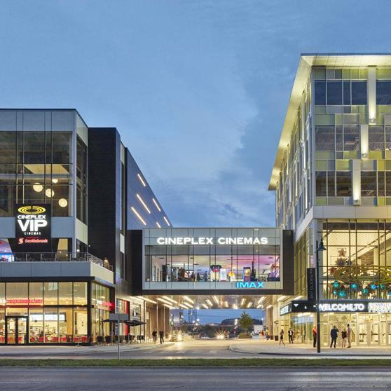 mixed-use buildings in Downtown Markham connected by a pedestrian walkway, with a Cineplex theatre