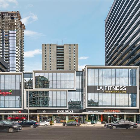 exterior rendering of the Yonge Sheppard Centre, showing the glazed retail section with main tenant LA Fitness, and the residential tower in the background