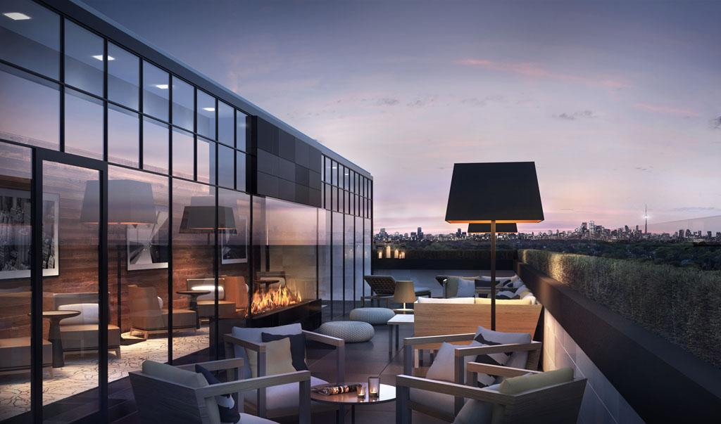 rendering of a rooftop amenity balcony with lounge seating and headlamps, with the CN Tower visible in the distance