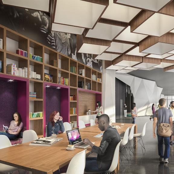 Co-working space for residents at York Condos with wooden bookshelves and light fixtures, and purple seating nooks inset into the millwork
