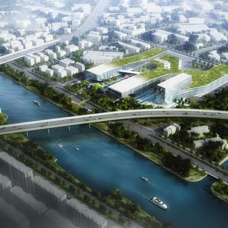Aerial view rendering of two bridges over a waterway, with a three winged building with a green roof in between the bridges on the right side of the water
