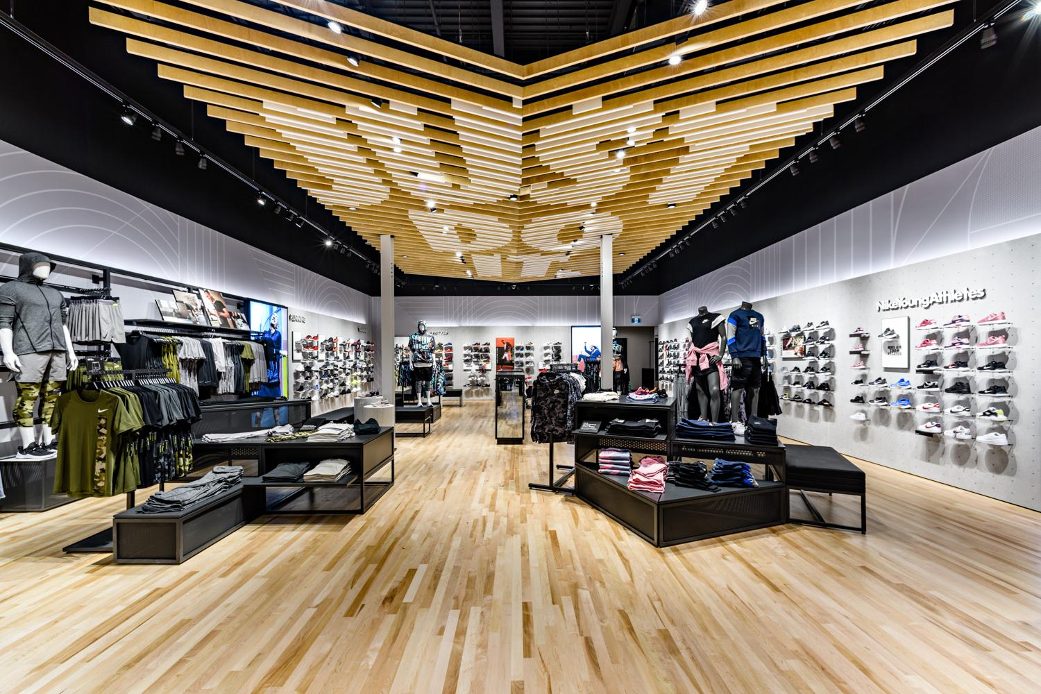 Nike retail store in Yorkdale Mall featuring dropped wooden slats on the ceiling with the words Just Do It.