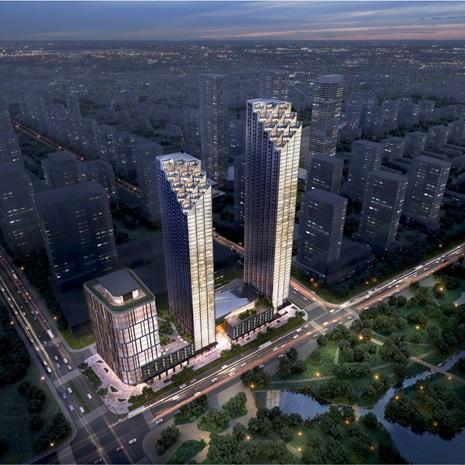 aerial rendering of a development with two high rise residential towers and one midrise office building