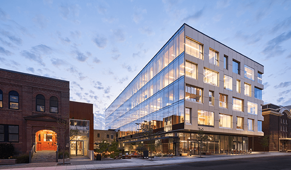 80 Atlantic a modern office building of five storeys with fully glazed south facade exposing the mass timber interiors