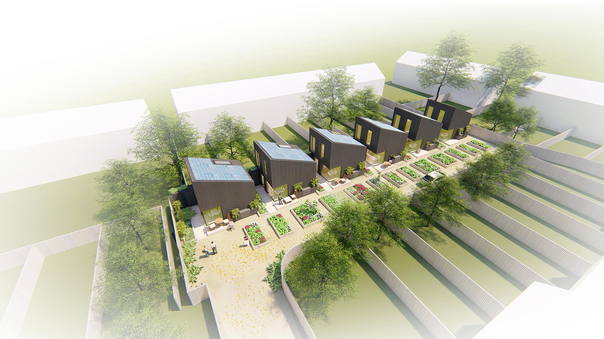 bird's eye view of six houses with dark cladding and slanted roofs and gardens in each yard