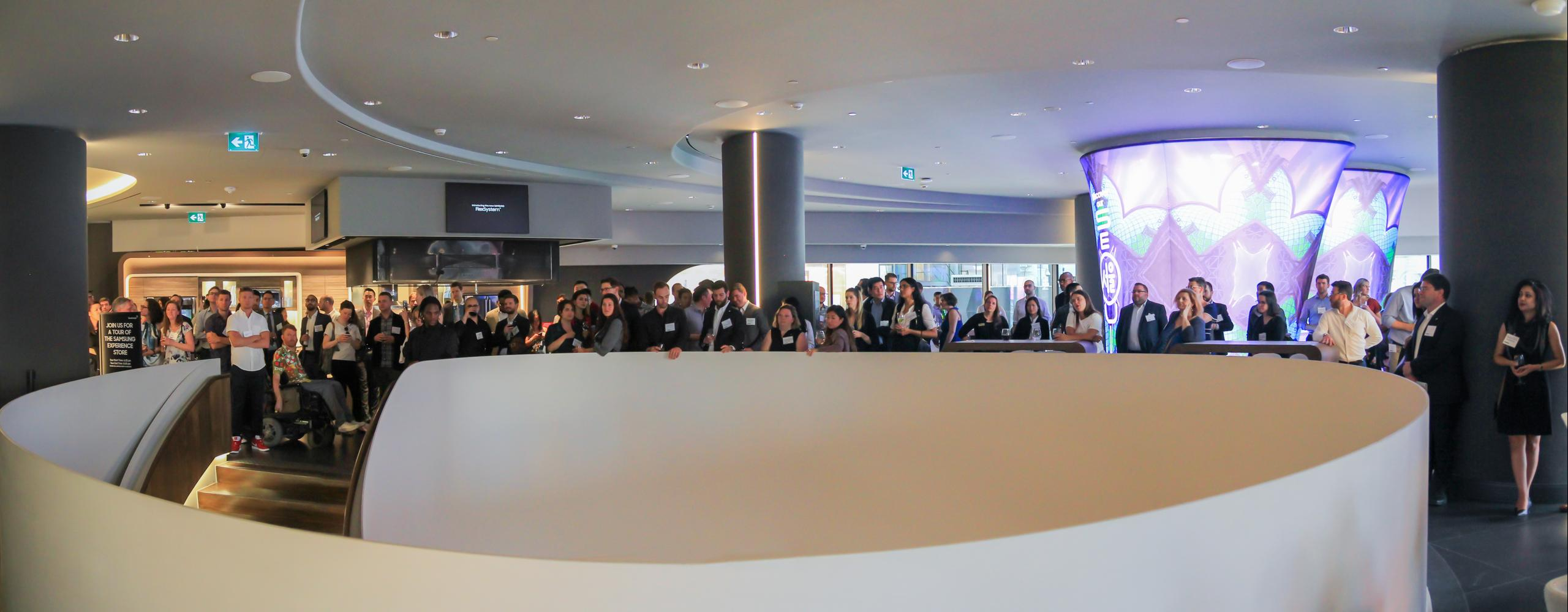 panorama photo of the second floor of the Samsung Experience Store full of people