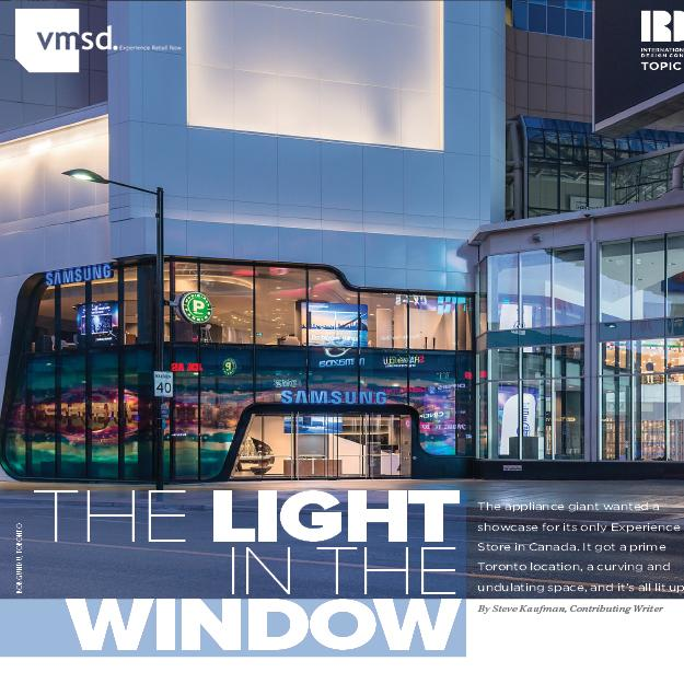 magazine article with a photo of the exterior of the Samsung Experience Store Eaton Centre colourfully lit up at dusk and the headline The Light in the Window