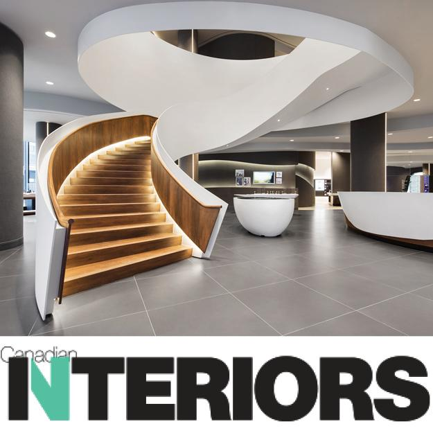 thumbnail image showing the grand white cuving staircase in the Samsung Eaton Centre store with the Canadian Interiors logo underneath