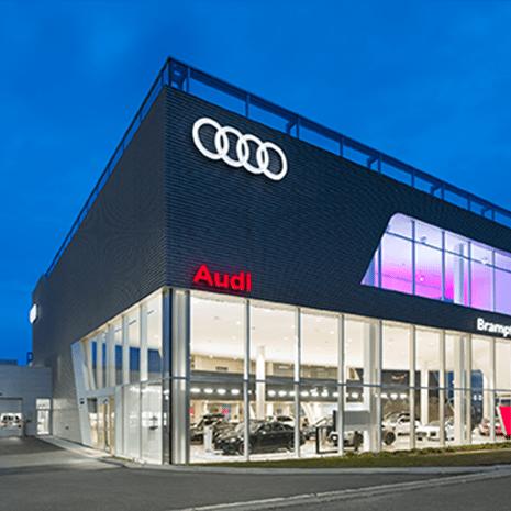 Audi Brampton car dealership at dusk