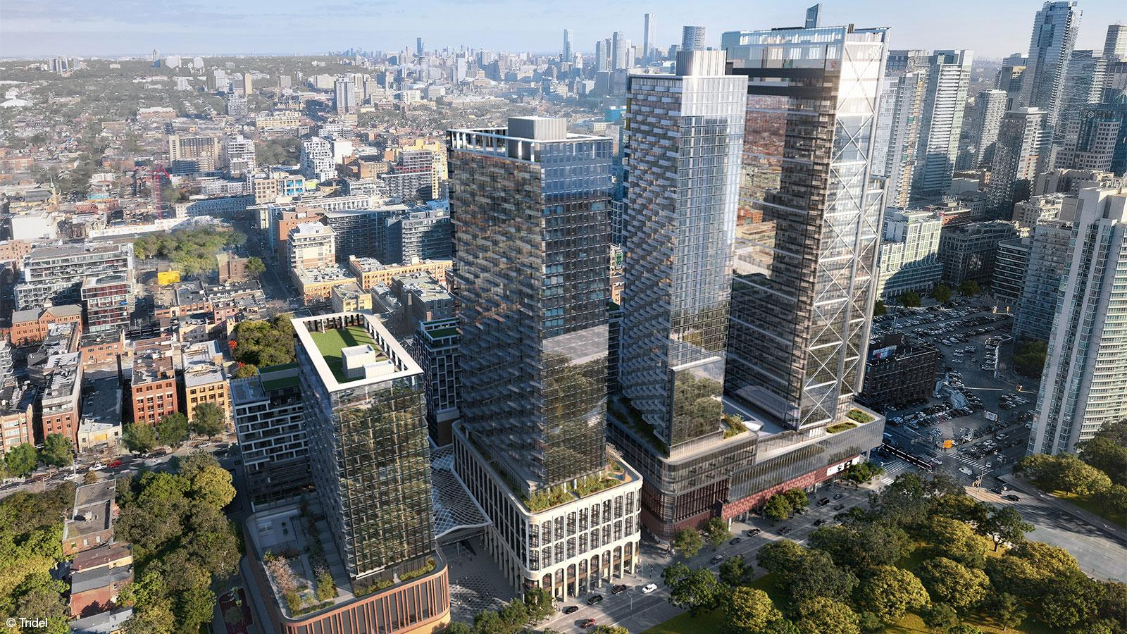 aerial rendering of a development with four high rise towers, each with their own podium of different styles, located in an urban environment
