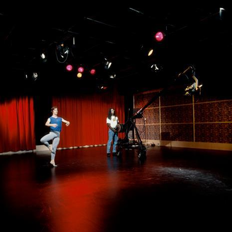 Dancer performing in a studio.