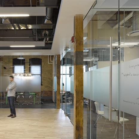 Glass enclosed meeting rooms.