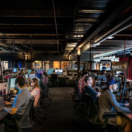 Dark open office workspace