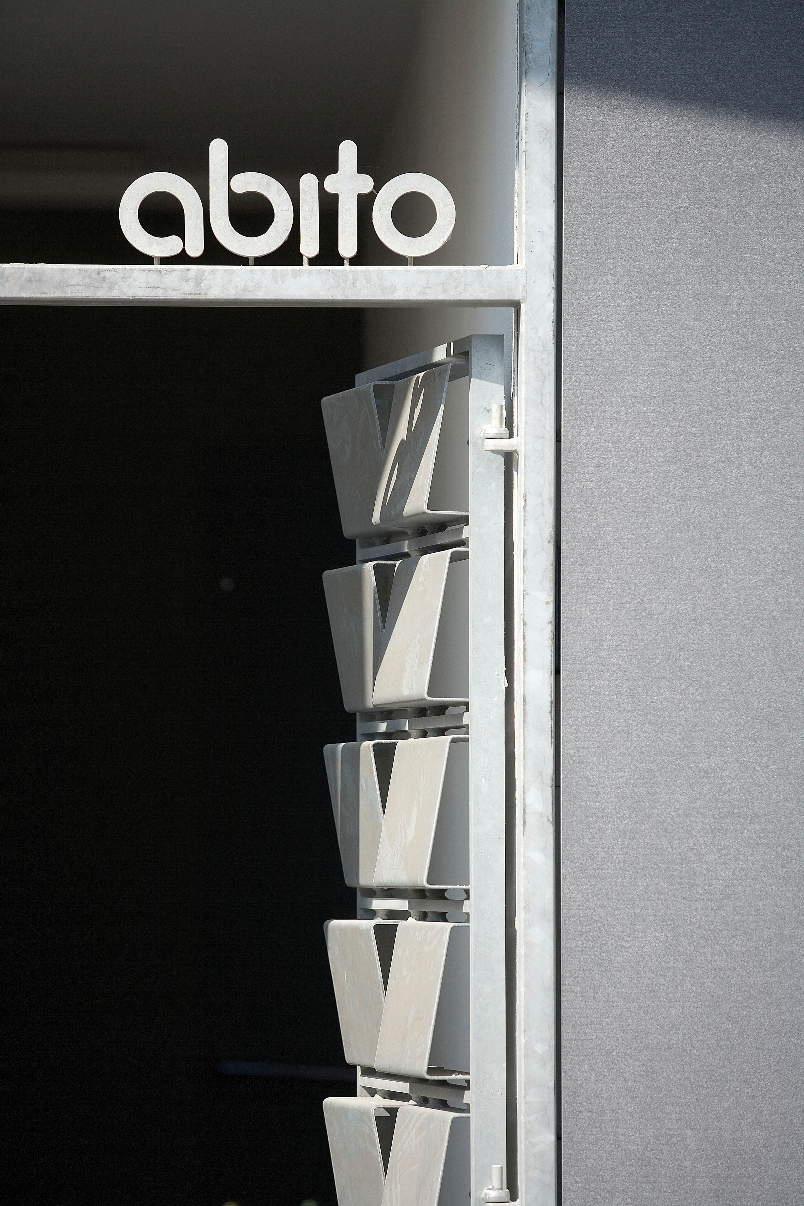 Abito signage over a doorway