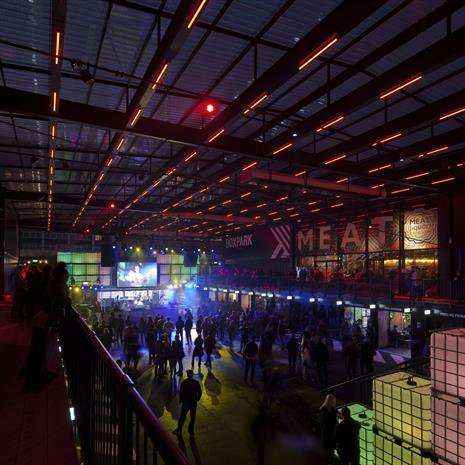 warehouse-style retail entertainment market at night viewed from the second level walkway