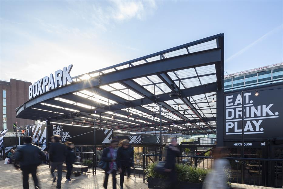 cantilevered metal canopy with Boxpark signage and Eat Drink Play signage, located outside with lots of pedestrians