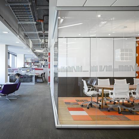 Glass encapsulated meeting room.