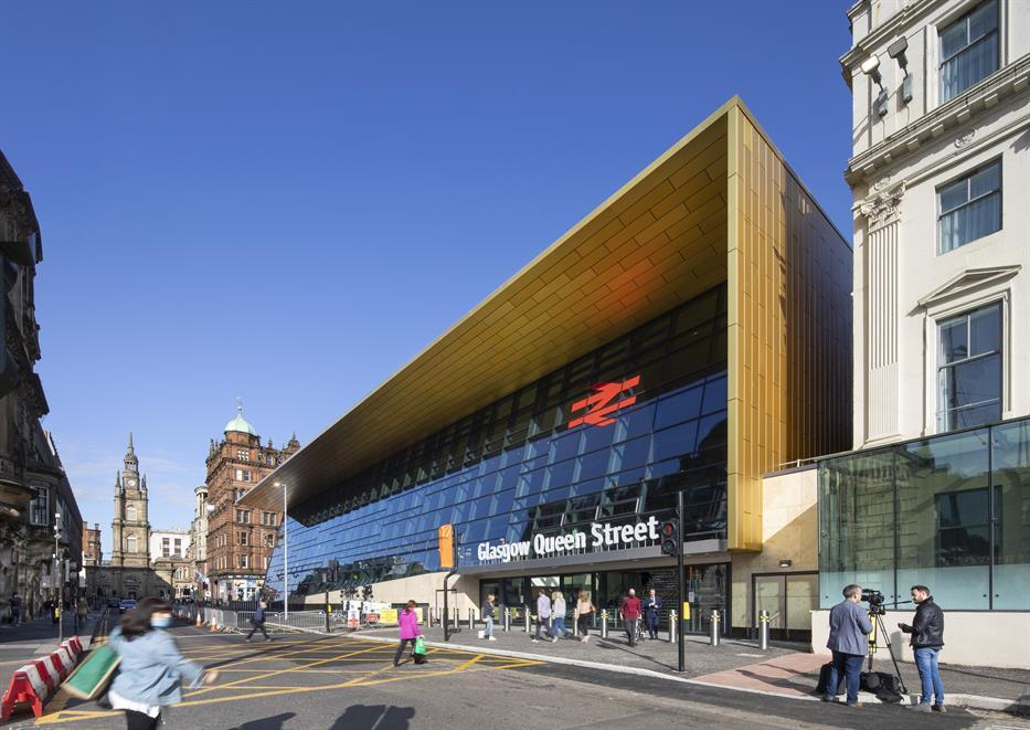 Glasgow Queen Street railway station, with modern fully glazed facade framed by a wooden awning