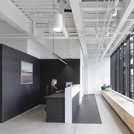 Interior shot of black and white reception desk and entrance
