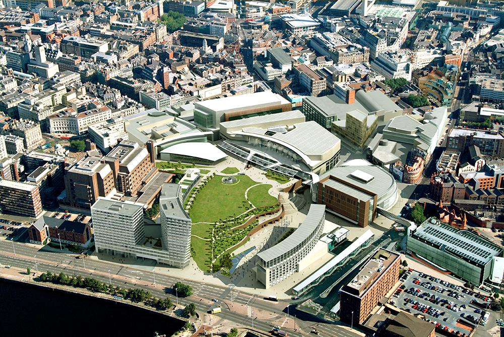 aerial photograph of Liverpool One, a retail and entertainment district, showing a large open green space with curved modern buildings around it