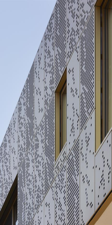 close up of copper alloy perforated facade