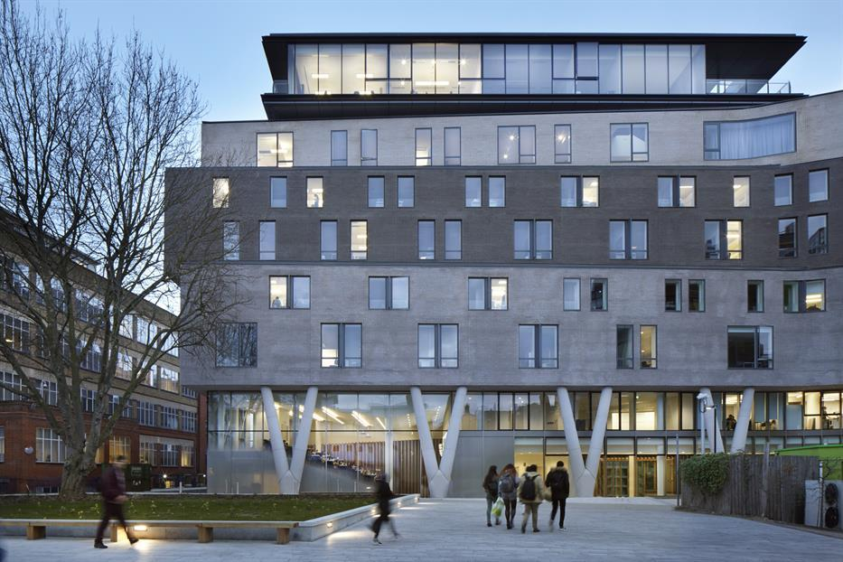 Queen Mary Graduate Centre, an eight storey building with glazing and angled columns at grade, brick facade that alternates from light to dark to light grey, and a glazed penthouse section on top