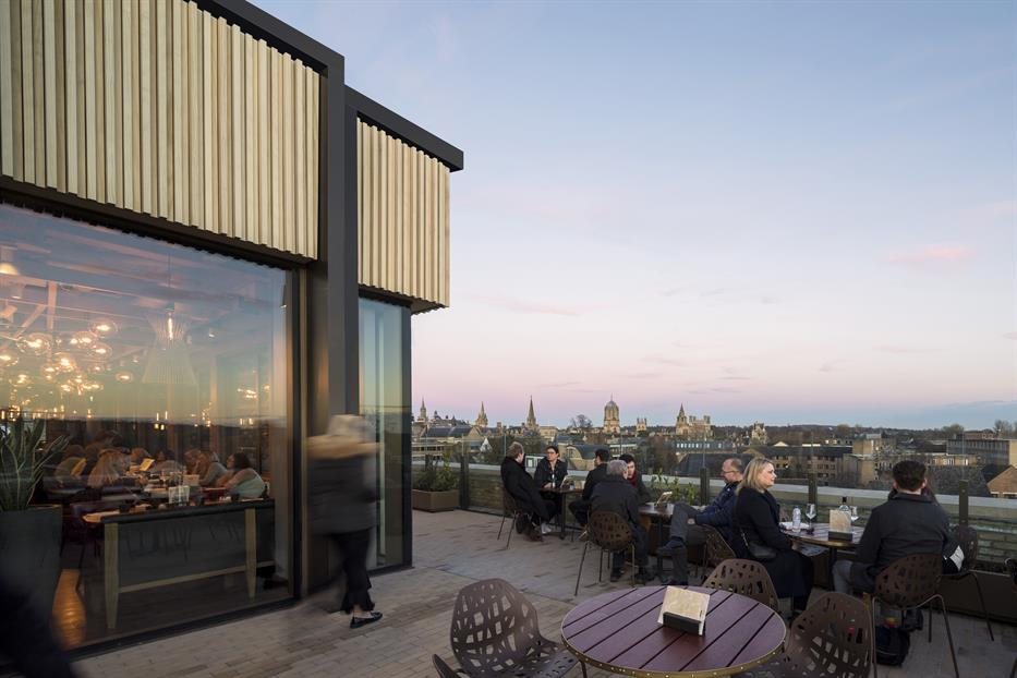 terrace patio of a restaurant overlooking a European city